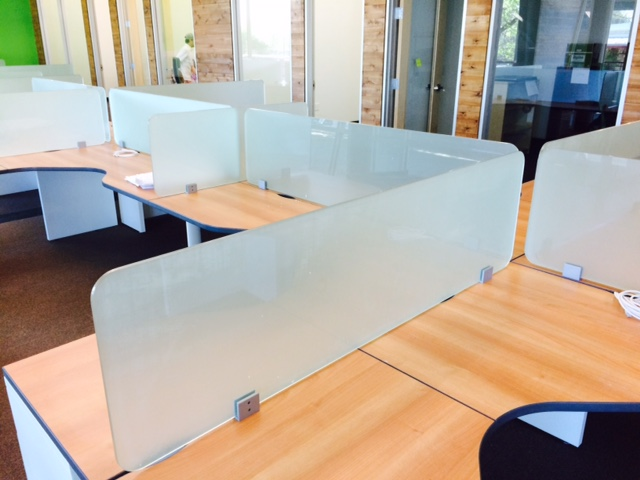 Use Of New Glass Partitions Mounted On Used Warm Maple L Shape Desks With Cubicle Work Surfaces And Painted White Legs Cabinets